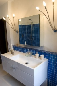 This photograph shows the proper alignment for bathroom vanity lights.
